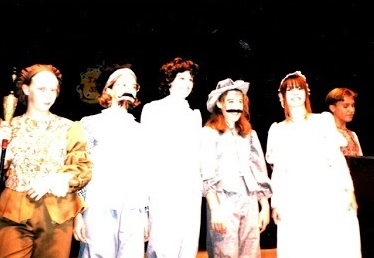 Images of six young women in costume (many as old men) in a production of the Taming of the Shrew.